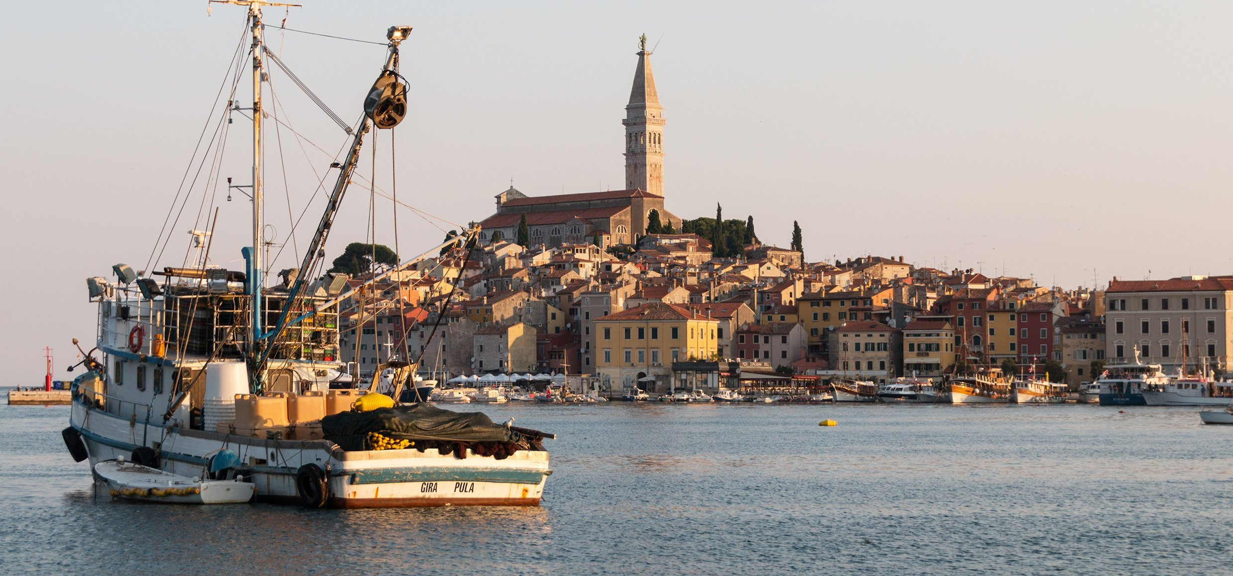 View of the old town of Rovinj by fishing boat, Croatia.