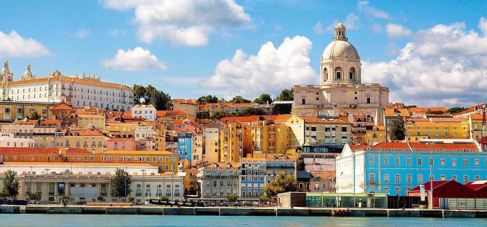 Beautiful view of Lisbon from the Tagus River. The scene is dominated by the Pantheon on the right hand side and the convent of Sao Vicent da Fora at upper left. This is the view that greets visitors arriving by cruise ship.