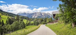 279_3_Mountain road view on Dachstein_AdobeStock_207100096_beachfront